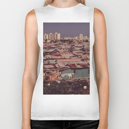 'MODERN BUILDINGS TOWER OVER THE SHANTIES CROWDED ALONG THE MARTIN PENA CANAL' Biker Tank