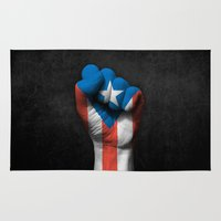 puerto rico Area & Throw Rugs featuring Puerto Rican Flag on a Raised Clenched Fist by Jeff Bartels