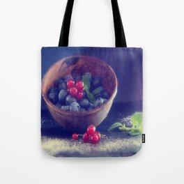 Dark blue berries contrasting with bright red berries Tote Bag