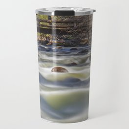 A bridge over the Merced River stands solidly over the velvety exposure of the water Travel Mug
