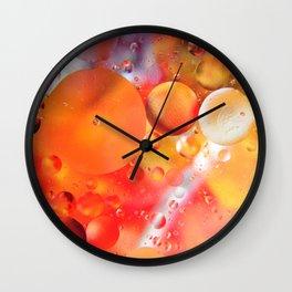 Bubbles in orange background Wall Clock