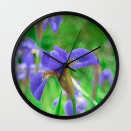 Group of purple irises in spring sunny day Wall Clock