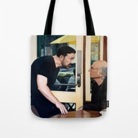 larry david Tote Bags featuring Ricky Gervais and Larry David Stare Down by Laura Baran