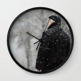 Man in snow Wall Clock