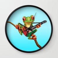 palestine Wall Clocks featuring Tree Frog Playing Acoustic Guitar with Flag of Palestine by Jeff Bartels