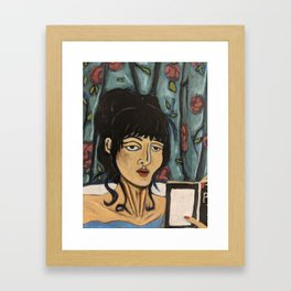woman reading in the tub Framed Art Print