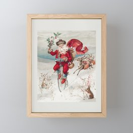 Santa Claus on a penny farthing with reindeer trailing and a rabbit from The Miriam And Ira D Wallac Framed Mini Art Print