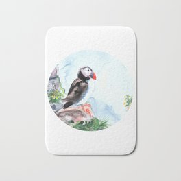 Atlanic Puffin sitting on the rocks by the ocean Bath Mat