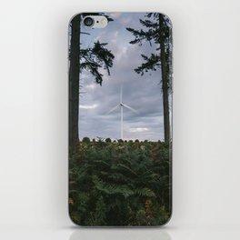 Wind turbine framed between two trees at dusk. Norfolk, UK. iPhone Skin