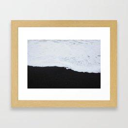 Black beach Framed Art Print