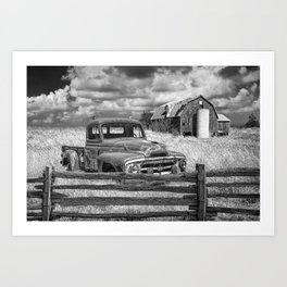Black and White of Rusted International Harvester Pickup Truck behind wooden fence with Red Barn in Art Print