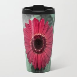 A Full Frontal Closeup of a Red Daisy Travel Mug