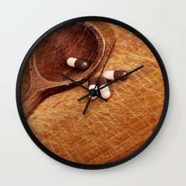 Suplement pills on wooden spoon Wall Clock