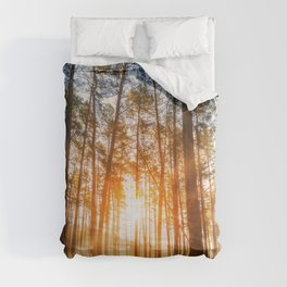 sunset behind trees in forest landscape - nature photography Comforters