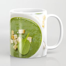Traditional Spinach cream soup with croutons and fresh spinach leaf on top Coffee Mug