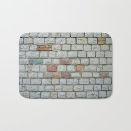 Wall of white bricks and other colors Bath Mat