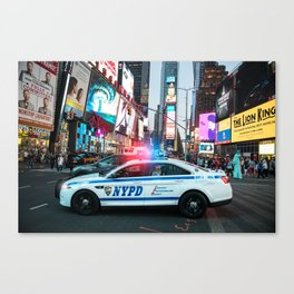 NYPD police squad car goes to emergency call with alarm and siren light in the Time Square streets o Canvas Print