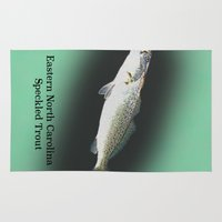 trout Area & Throw Rugs featuring Dad's Speckled trout by Kyle Ellsworth