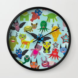 Cute cartoon Monsters seamless pattern on blue background Wall Clock