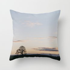 Tree on a hilltop above Matlock silhouetted at twilight. Derbyshire, UK. Throw Pillow