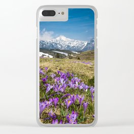 Mountains and crocus flowers on Velika Planina, Slovenia Clear iPhone Case