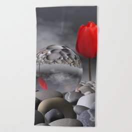 tulip, pebbles and breaking light Beach Towel