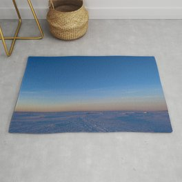 Dawn in the blue cloudless sky over the white snow ice desert of the frozen sea Rug