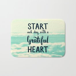 Start each day with a grateful heart Text on sea photo Bath Mat