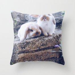 Bunnies rock climbing Throw Pillow