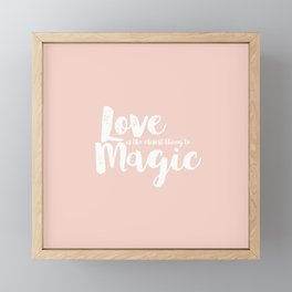 LOVE is the closest think to magic - Saying on peach background Framed Mini Art Print