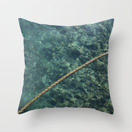 Rope over clear water Throw Pillow