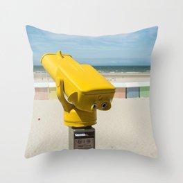 Yellow spotting scope on the beach Throw Pillow