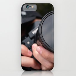 Professional Photographer taking a picture with the camera iPhone Case