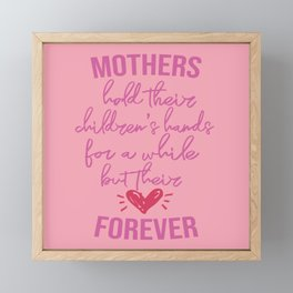 Mothers hold their children's hands for a while but their hearts forever. Framed Mini Art Print