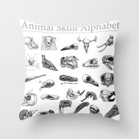 animal skull Throw Pillows featuring Animal Skull Alphabet by Stephan Brusche
