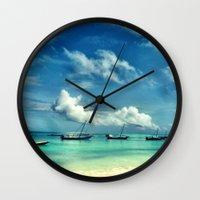 hakuna Wall Clocks featuring Hakuna Matata by Anna Andretta