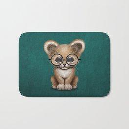 Cute Baby Lion Cub Wearing Glasses on Blue Bath Mat