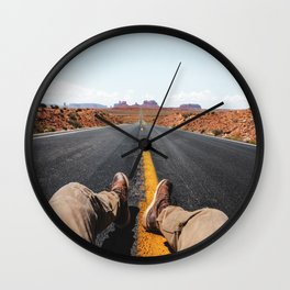 on the road in the monument valley Wall Clock