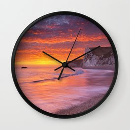 Cliffs at Durdle Door beach in Southern England at sunset Wall Clock
