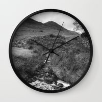 cassia beck Wall Clocks featuring Cinnerdale Beck above Crummock Water with Whiteless Pike beyond. Lake District, UK. by liamgrantfoto