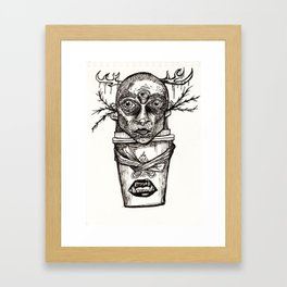 A coffee cup Framed Art Print