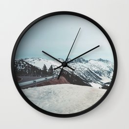 a road among the mountains Wall Clock