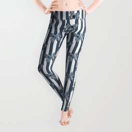 Blue butterflies on a striped background . Leggings