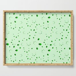 A lot of green drops and petals on a grassy background in mother of pearl. Serving Tray