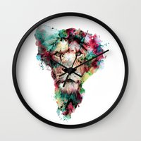 king Wall Clocks featuring THE KING by RIZA PEKER