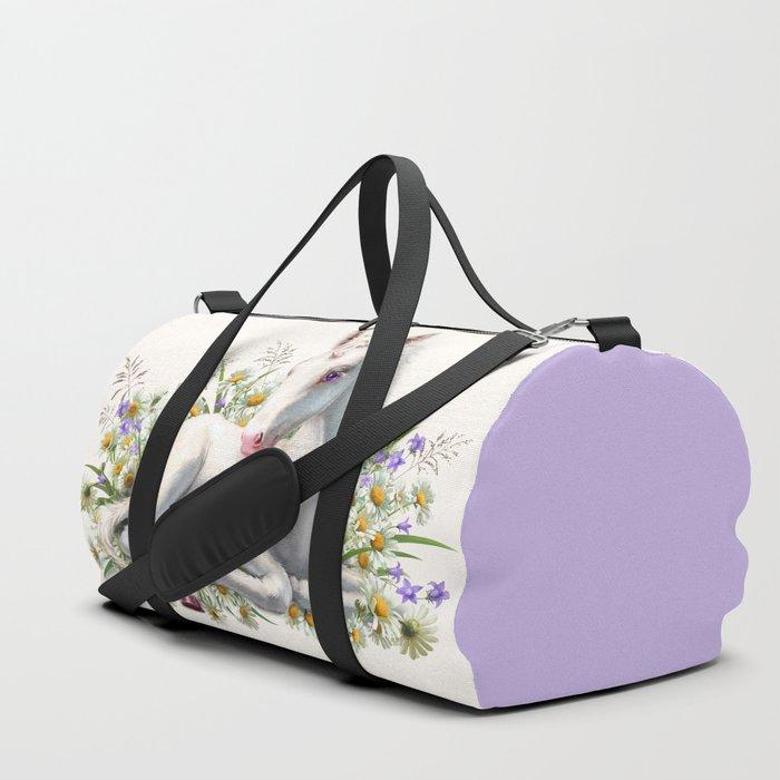Baby unicorn lies in flowers Duffle Bag