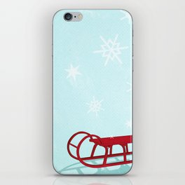 Red sledge in the snow iPhone Skin