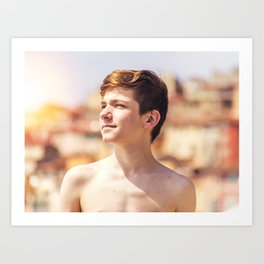 Boy relaxing on a beach in French Riviera Art Print