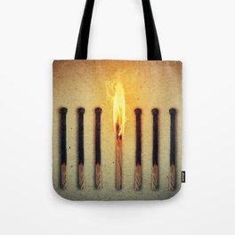 match burning alone Tote Bag