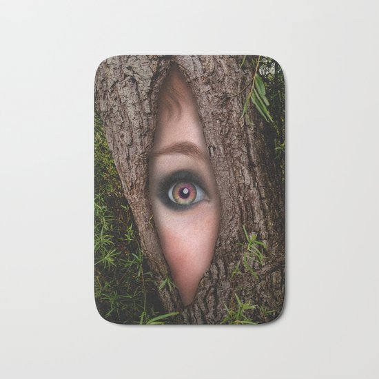 Beautiful Face trapped in a tree trunk Bath Mat